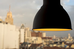 Lamp in the window. With Madrid city sky Royalty Free Stock Photos