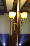 Lamp in window Stock Photo