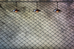 Lamp with wired fence and Grungy concrete wall Royalty Free Stock Photo