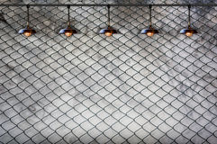 Lamp with wired fence and Grungy concrete wall Stock Image