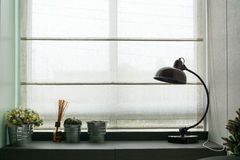 Lamp on wooden desk Stock Photography