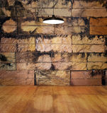 Lamp on wooden floor rotten and stain stone old brick wall background Royalty Free Stock Photos