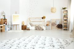 Bright kid`s bedroom with clothes Stock Photos