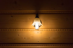 Lamp on the wooden wall Stock Photos
