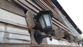 Lamp on wooden wall Royalty Free Stock Photo
