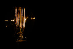 Lamp. Yellow light on black background Stock Photos