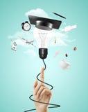 Lampa med avläggande av examenhatten arkivbild