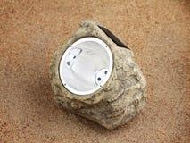 Lampa med fotocellen på sanden Royaltyfri Foto