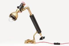 Lampada bronzea dell'annata con una lampadina Fotografie Stock Libere da Diritti