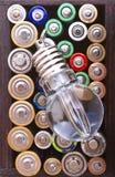 Lampada di flusso e fondo delle batterie Immagini Stock