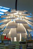 Lampada di legno in una fine moderna di stile su fotografia stock libera da diritti