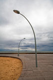 Lampada di via due sul molo Fotografia Stock Libera da Diritti