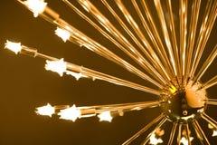 Lampada dorata con le lampadine Fotografie Stock