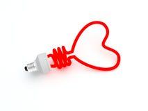 Lampada economizzatrice d'energia sotto forma del cuore Fotografia Stock Libera da Diritti