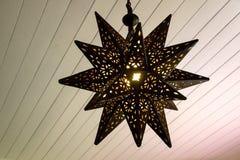 Lampada a forma di stella arrugginita. Fotografie Stock