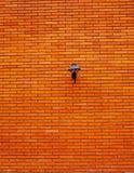 Lampada sul muro di mattoni arancio Fotografia Stock Libera da Diritti