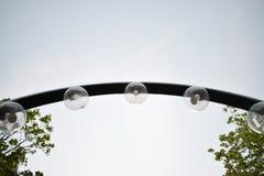 Lampade di luce nella città Fotografie Stock Libere da Diritti