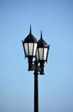 Lampade di via su cielo blu Fotografia Stock