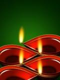 Lampade a olio di Diwali sopra fondo verde Fotografia Stock Libera da Diritti