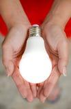 Lampadina del LED - energia nel nostro hand2 Fotografia Stock