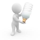 lampadina della holding dell'uomo 3D Fotografia Stock
