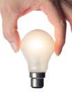Lampadina illuminata holding della mano senza il cavo elettrico Fotografia Stock Libera da Diritti