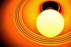 Lampadina incandescente arancione Fotografia Stock