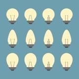 Lampadine ed insieme dell'icona della lampadina  Immagini Stock