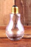 Lampadine sui precedenti di legno Fotografia Stock