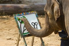 LAMPANG, THAILAND - April 13, 2017:- Elephant painting in picture tree frame at The Thai Elephant Conservation stock photos