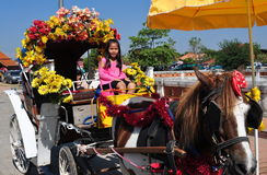 Lampang, Thailand: Little Girl in Horse Carriage Stock Image