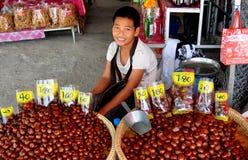 Lampang, Thailand: Man Selling Chestnuts Stock Photos