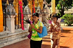 Lampang, Thailand: Praying Women at Thai Wat Royalty Free Stock Image