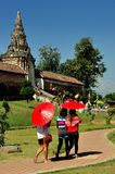 Lampang, Thailand: Women with Parasols at Thai Wat Stock Photography