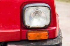 Lampdelen voor de rode uitstekende auto royalty-vrije stock foto
