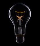 Lampe auf schwarzem Hintergrund Stockbild