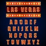 Lampe d'alphabets de néon léger d'or sur le fond bleu Photos libres de droits