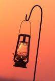 Lampe d'ouragan en silhouette Images stock