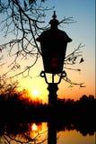 Lampe dans le lever de soleil Photo stock