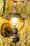 Lampe de mur sur le fond du blé Photo stock