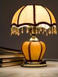 Lampe et livres Photographie stock libre de droits