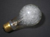 Lampe flash de magnésium sur un fond de tissu Photos libres de droits