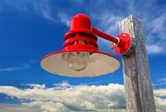 Lampe rouge dans le port Photo stock