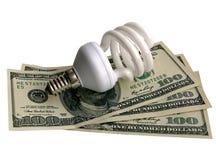 Lampe sur des dollars Photographie stock