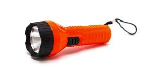 Lampe-torche électrique de poche rouge et noire sur le blanc Photos stock