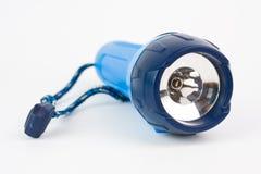 Lampe-torche électrique de poche sur le fond blanc Photographie stock libre de droits