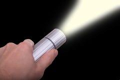 Lampe-torche de fixation de main Photographie stock libre de droits