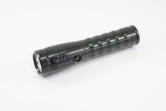 Lampe-torche noire en acier sur le fond blanc d'isolement Images stock