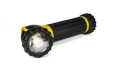 Lampe-torche noire et jaune d'isolement Photo libre de droits