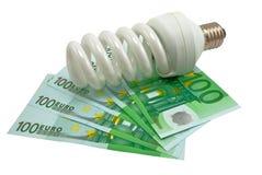 Lampe und Geld Stockfotos